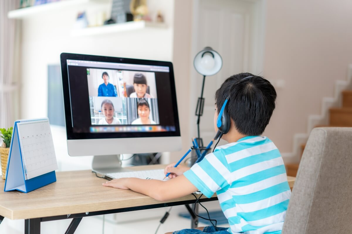 boy attending online classes of English